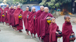 Monks collect alms in