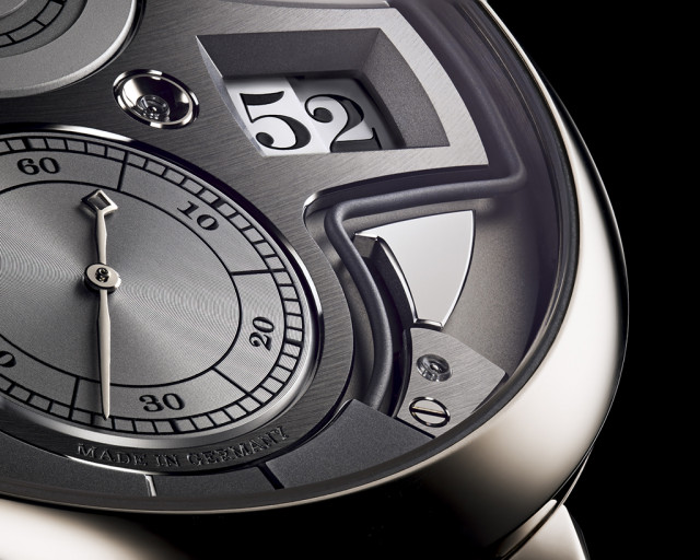 The striking action is visible on the dial, which also displays jumping hours and minutes, subsidiary seconds with stop seconds, and power-reserve.